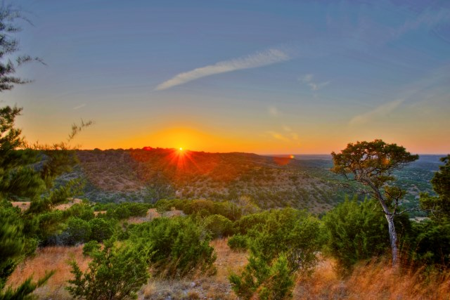 Sweetwater's dramatic Hill Country topography often makes it possible to create a multilevel backyard with an outdoor kitchen, a pool and multiple seating areas.  And the sunsets are spectacular!