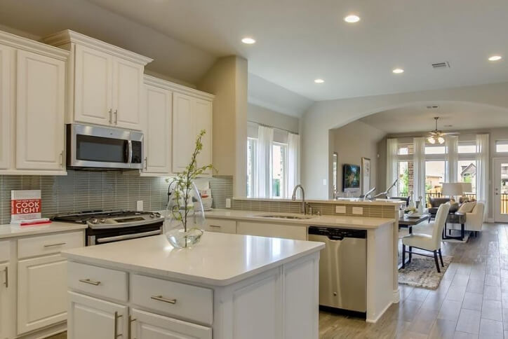 Perry Homes Plan 1950W model home kitchen at Sweetwater community Austin, TX