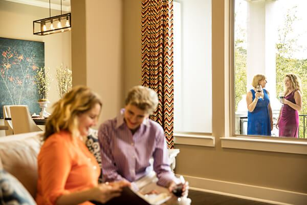 Women chatting at model home in Sweetwater community Austin, TX